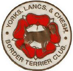 Yorks, Lancs & Chesh Border Terrier Club logo cream circle with red roundle with border terrier in the centre and text around the edge